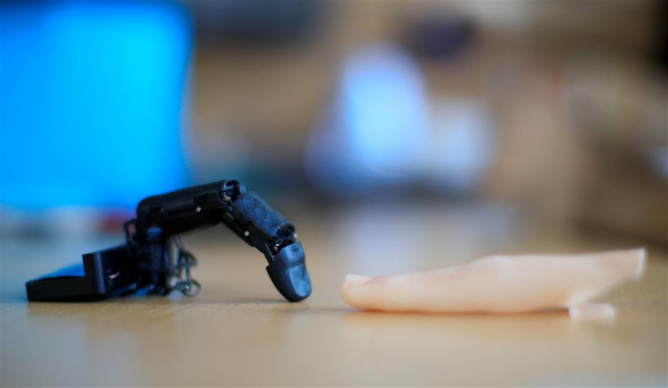The robot finger \'MobiLimb\' that attaches to a mobile phone, invented by Marc Teyssier, a PhD student at Telecom Paris Tech Engineering school, is displayed after an interview with Reuters in Paris, France October 9, 2018. Picture taken on October 9, 2018. REUTERS/Gonzalo Fuentes
