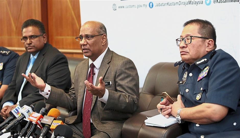 Talking revenue: Subromaniam (centre) speaking to the media after the SST implementation briefing session while deputy undersecretary of the Finance Ministry's tax division MA Sivanesan (left) and Customs Department deputy DG Datuk Paddy Abd Halim look on.