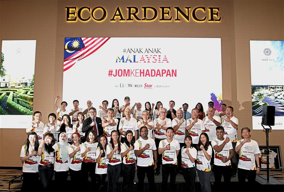 Proud to be Malaysian: (Second row, starting sixth from left) Wong, Lee and Liew showing off their T-shirts and wristbands along with the campaign team from Eco World Development Group Bhd and Star Media Group, celebrities and influencers during the launch at Eco Ardence in Setia Alam.