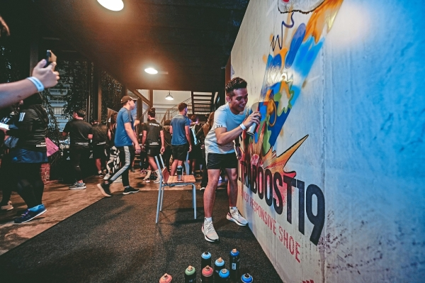 Runners completing a graffiti wall dedicated to the new adidas Ultraboost 19.