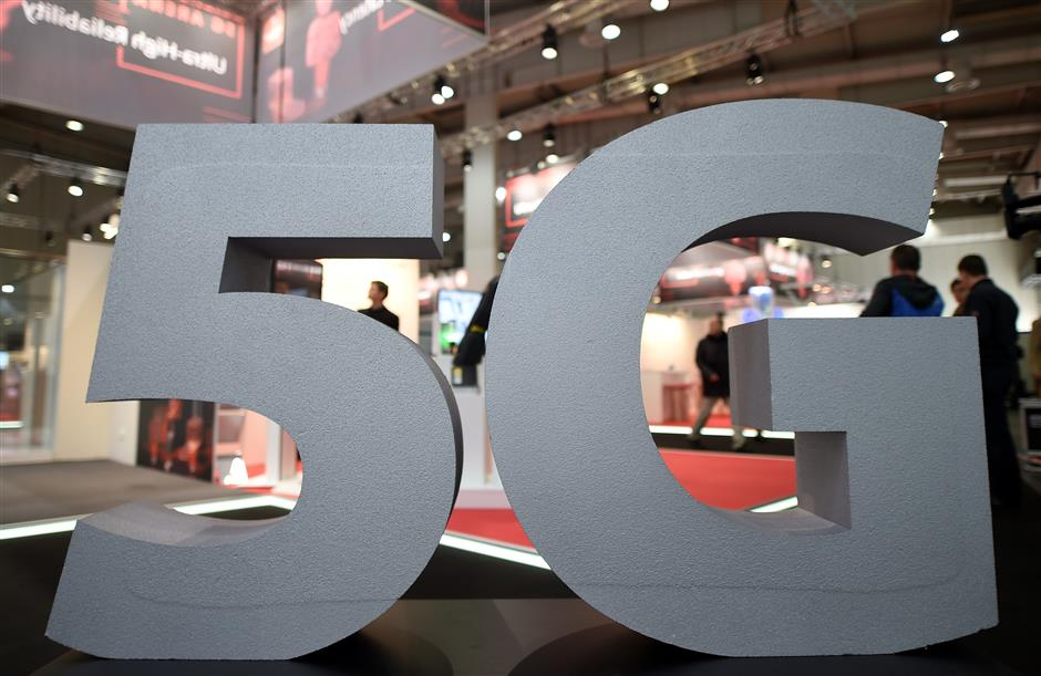 A logo of the upcoming mobile standard 5G is pictured at the Hanover trade fair, in Hanover, Germany March 31, 2019. REUTERS/Fabian Bimmer