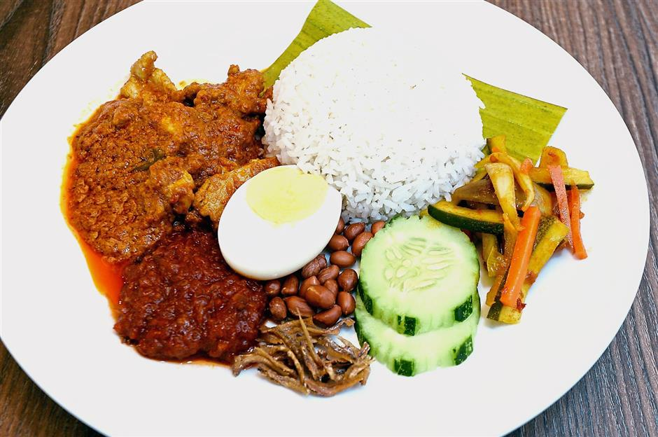 Nasi Lemak with Pork Curry is one of the signature dishes at Tables of Joy.