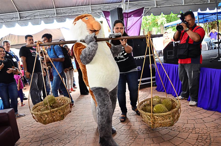 Tourism Malaysia's monkey mascot performing a gimmick at the Penang National Park.