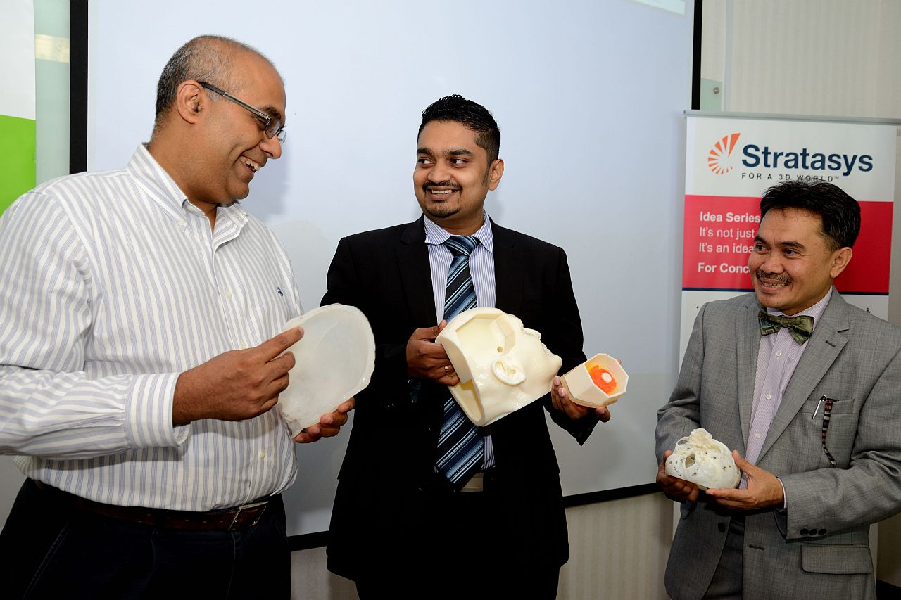STEADY HANDS: (l-r) Dr Vicknes Waran, Yuwaraj, and Dr Zainal holding the 3D printed parts produced by CBMTI.