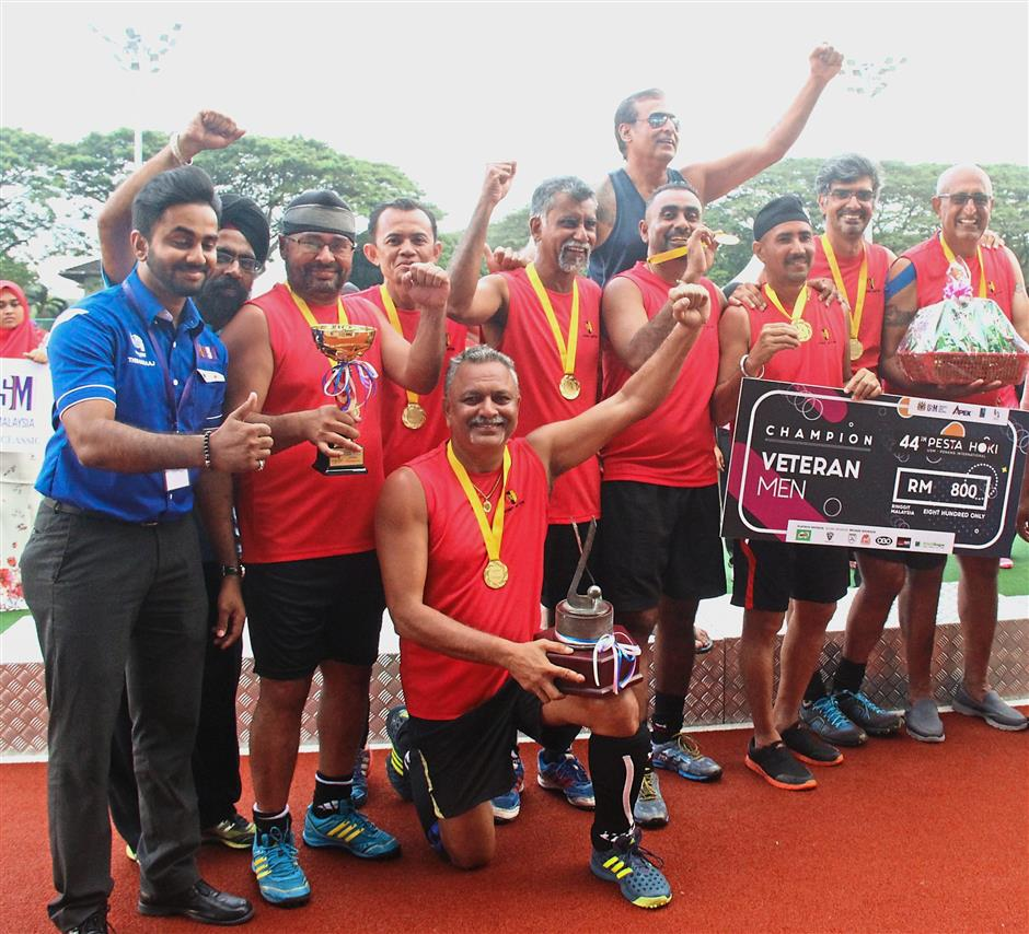 ^ Penang Sports Club celebrating after being crowned the new Men's Open Veteran champions at the Penang Pesta International Hockey Tournament.
