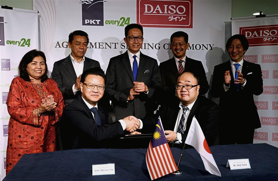 Itu2019s a deal: PKT Logistics Group MD and group chief executive Datuk Michael Tio (seated, left) and Daiso Industries, Japan president Seiji Yano with the signed service agreement,. The event was witnessed by (from left) Jalilah, Transport Ministry deputy secretary-general (policy) Mohd Khairul Adib Abdul Rahman, Selangor exco member Datuk Teng Chang Khim, Invest Selangor CEO Datuk Hasan Azhari and Daisei every24, Japan president Takamasa Tanaka.