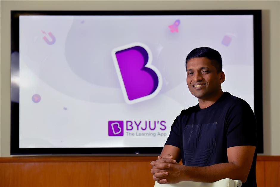 In this photo taken on January 10, 2019, Byju Raveendran, founder of Byju's, the Bangalore-based educational technology start-up, poses at the company's premises in Bangalore. - From a multi-billion-dollar education startup to wired-up mannequins, technology is helping to revolutionise the way Indian schoolchildren are learning -- provided their parents can afford it. (Photo by MANJUNATH KIRAN / AFP) / To go with 'INDIA-ECONOMY-EDUCATION-TECHNOLOGY-AMAZON',FOCUS by Vishal MANVE