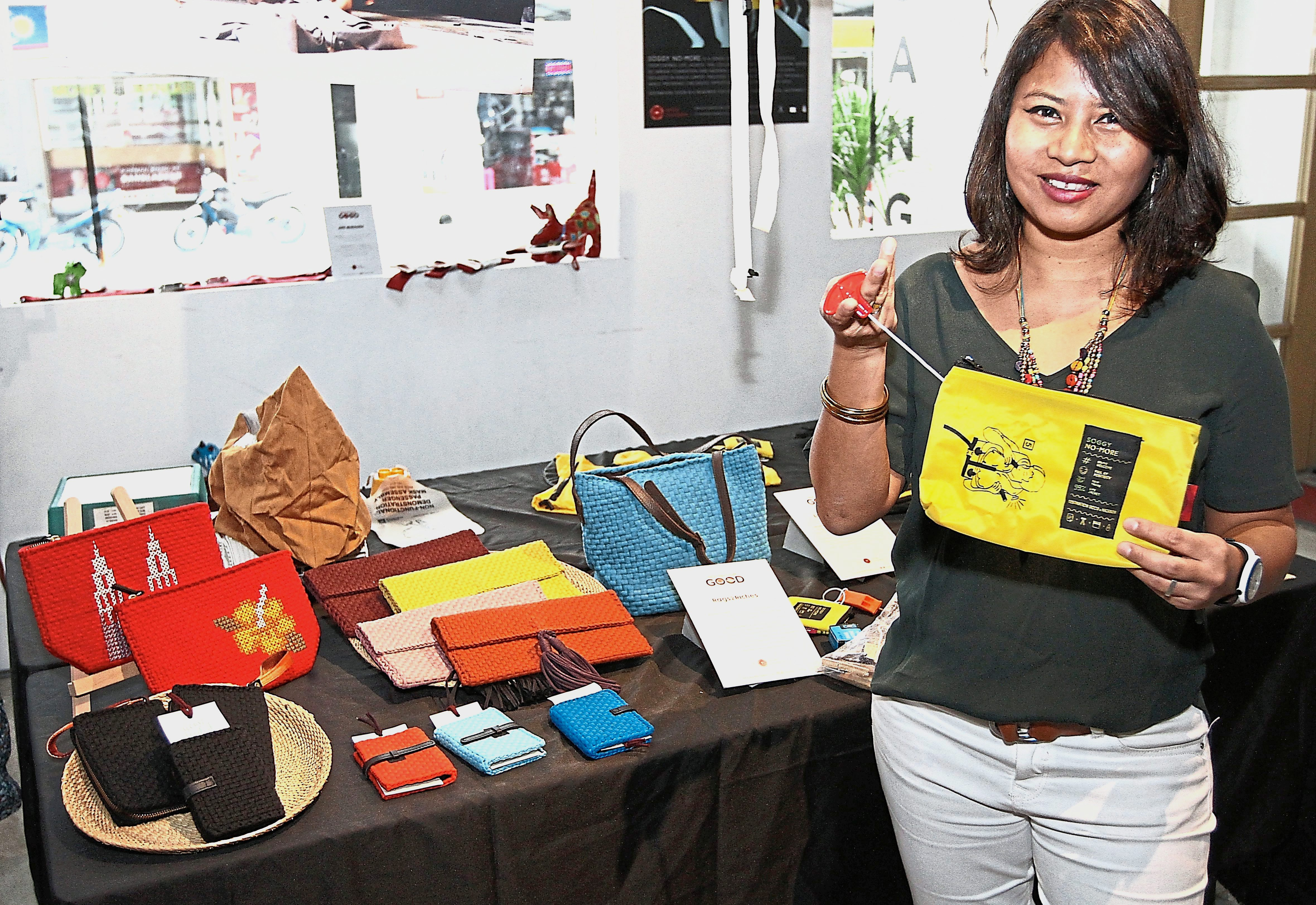 Eke holding a pouch from the Soggy No More collection, which are made from expired life jackets by a social enterprise of Afghan refugees in Kuala Lumpur.