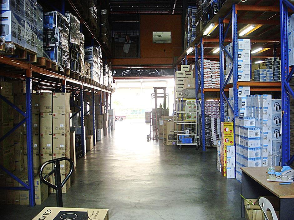 Products stored at SEC's warehouse in Bayan Lepas. The company says sales figures for the last few months of 2013 dropped.