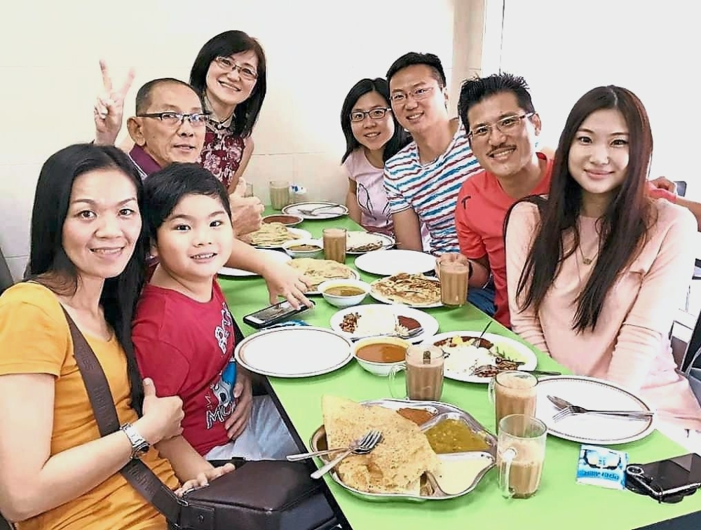 For Tey (right) and her family, mamak food is something they look forward to having on the first day of CNY.