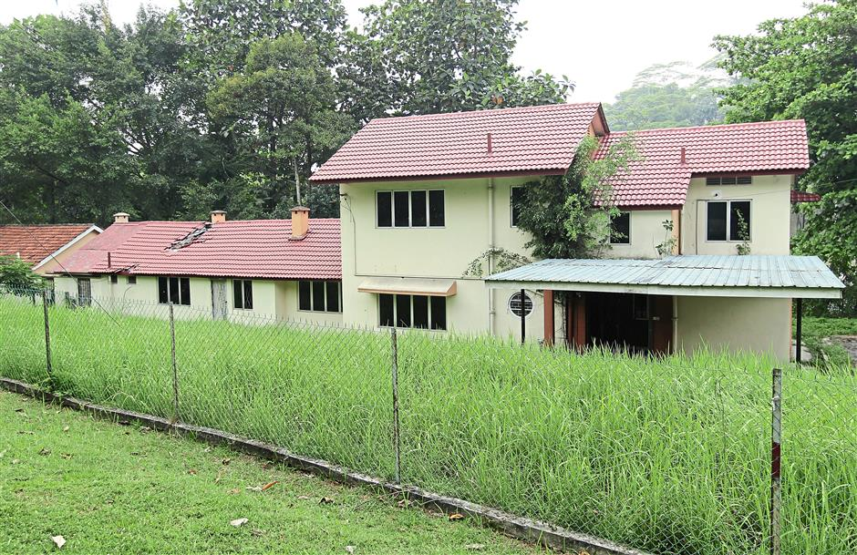 Sorry state: One of the many government bungalows in Jalan Belfield, broken and unattended.