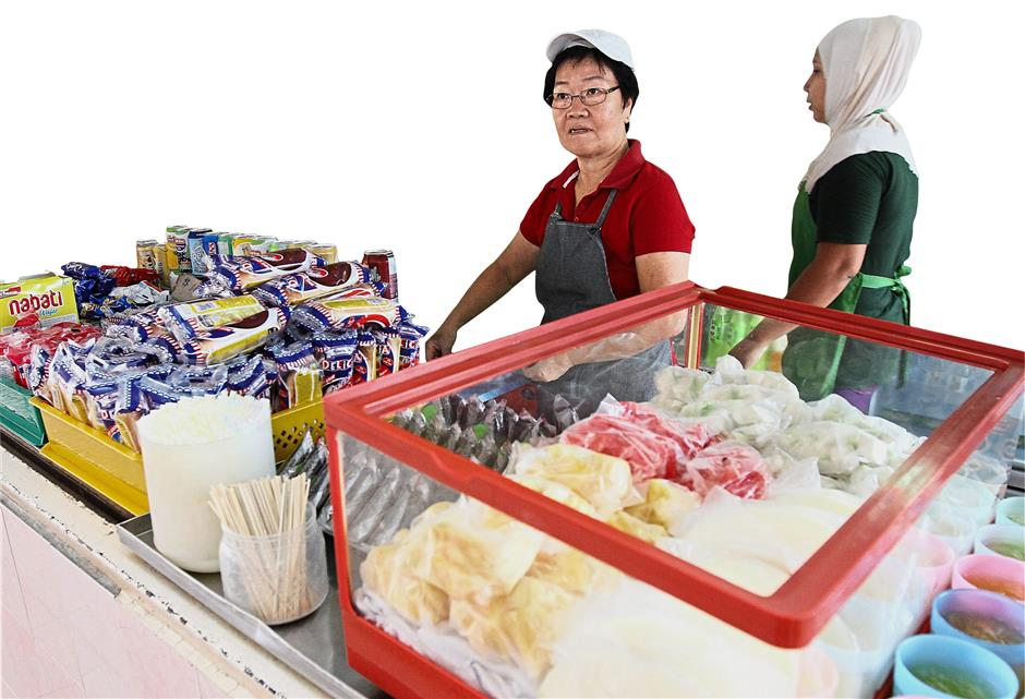School canteens are no longer allowed to sell cream buns and other junk food. — Filepic