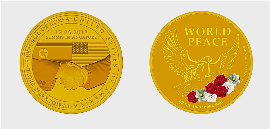 Special coins: The design of a gold-plated commemorative medallion depicting a handshake with images of the US and North Korean national flags on one side and an inscription 'World Peace' with images of the US and North Korean national flowers – roses and magnolias – on the other side. — AFP