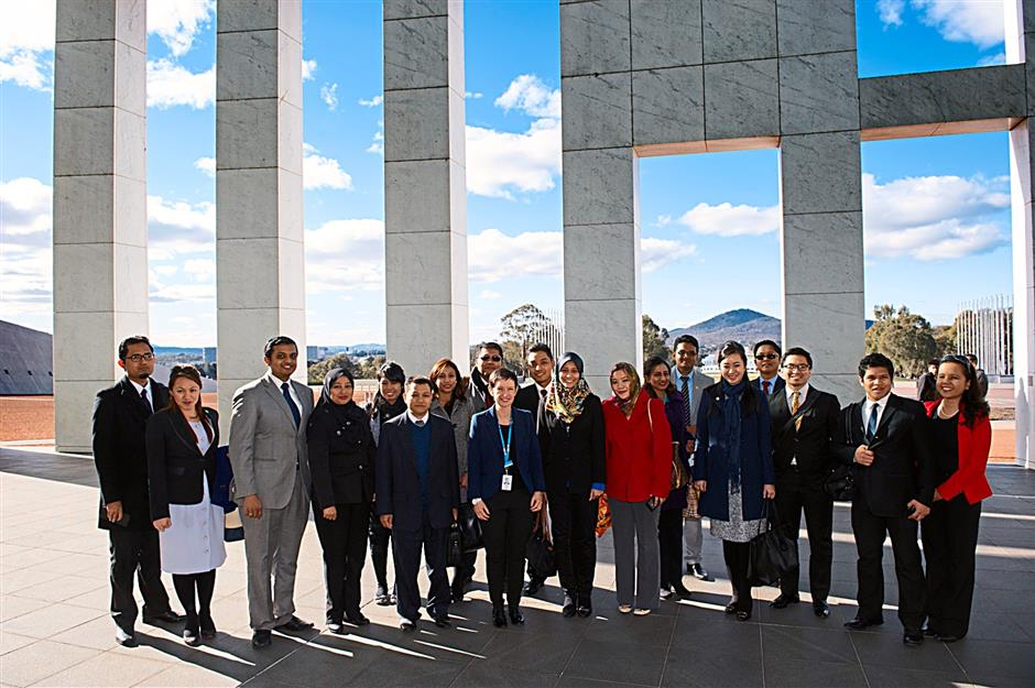 Malaysian young diplomats being welcomed by Department of Parliamentary Services Secretary, Carol Mills. The diplomats toured Parliament House in Canberra, Australia.