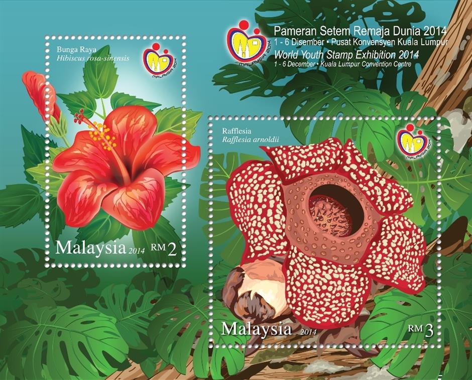 A stamp of a hibiscus and Rafflesia flower are featured under Fauna miniature sheets, being released by Pos Malaysia during the 2014 Kuala Lumpur World Youth Stamp Exhibition in Kuala Lumpur.