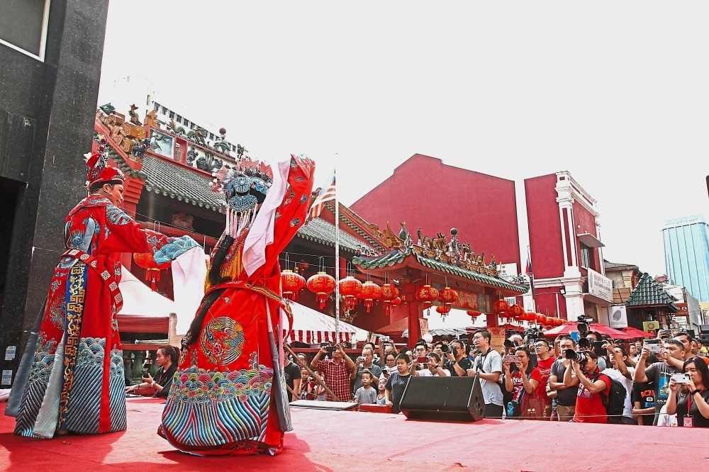 Two performers entertaining the crowd in a Teochew opera show at Jalan Tun H.S. Lee in Kuala Lumpur. — Photos: LOW BOON TAT/The Star