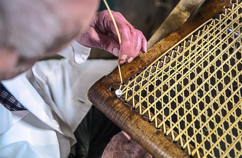 Lee has been re-caning chairs for nearly eight decades.