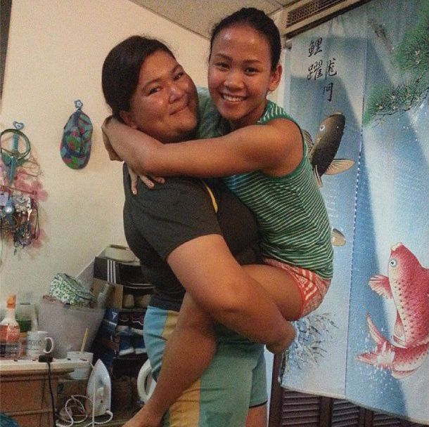 Diver Pandelela Rinong gets a 'lift' from weightlifter Nur Jannah Batrisyah Abdullah on the occasion of her birthday this year.