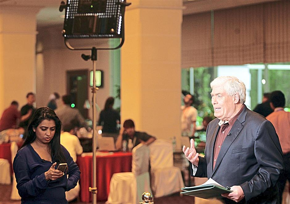 CNN anchor, Jim Clancy covering the missing flight MH370 at Sama Sama Hotel yesterday. AZMAN GHANI / The Star