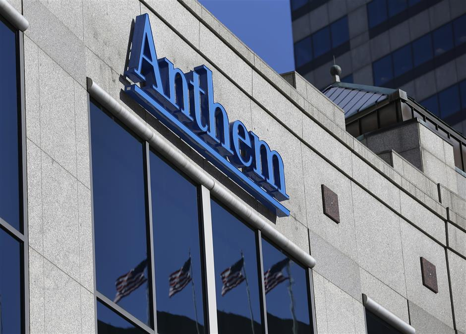 FILE - In this Thursday, Feb. 5, 2015, file photo, the Anthem logo hangs at the health insurer\'s corporate headquarters in Indianapolis. Anthem Inc. reports earnings Wednesday, April 25, 2018. (AP Photo/Michael Conroy, File)