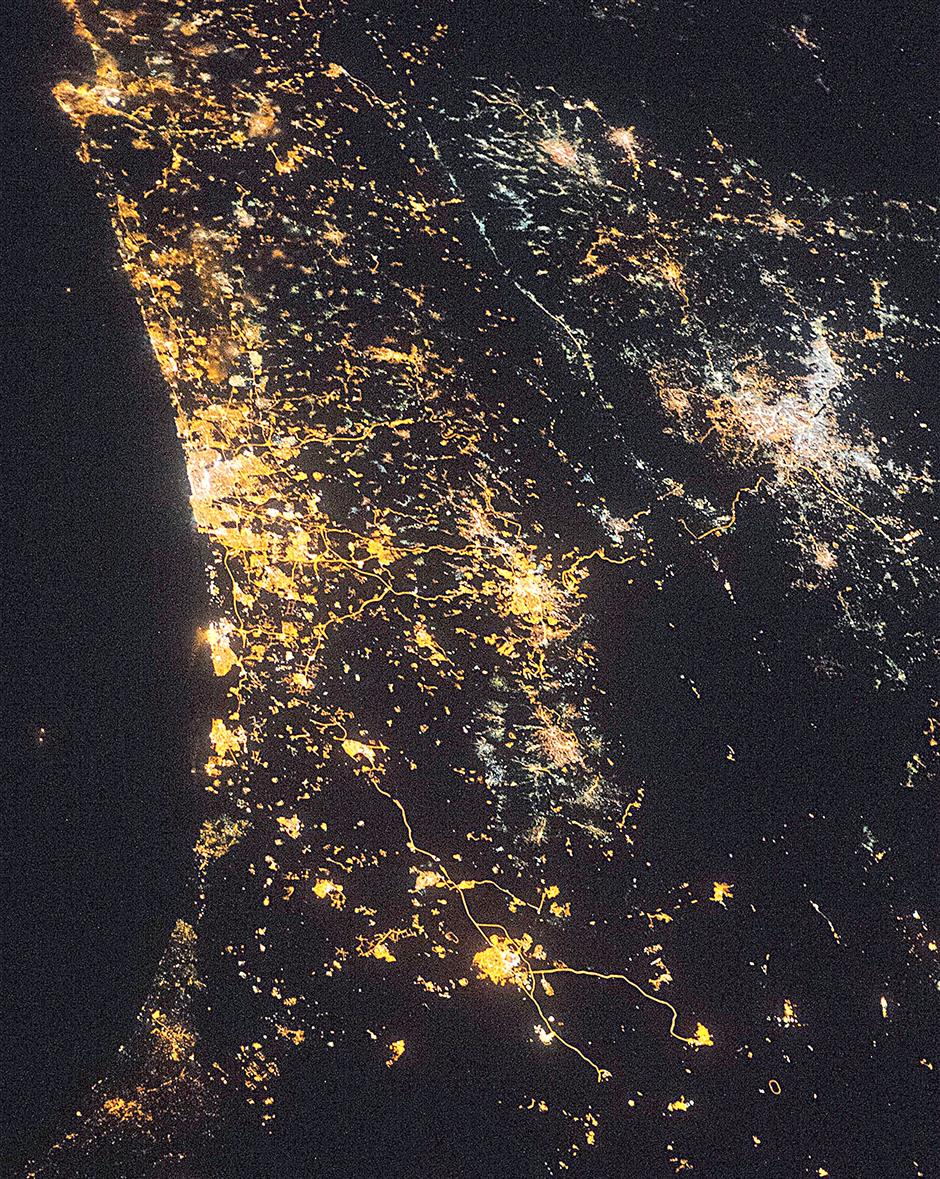 City lights are visible from space. The largest, brightest cluster on the left is the Israeli city of Tel Aviv, a port set against the blackness of the Mediterranean Sea. Israel's capital city, Jerusalem, is in the centre while Jordan's capital, Amman, is on the right (lights have a whiter tone). – NASA/AFP