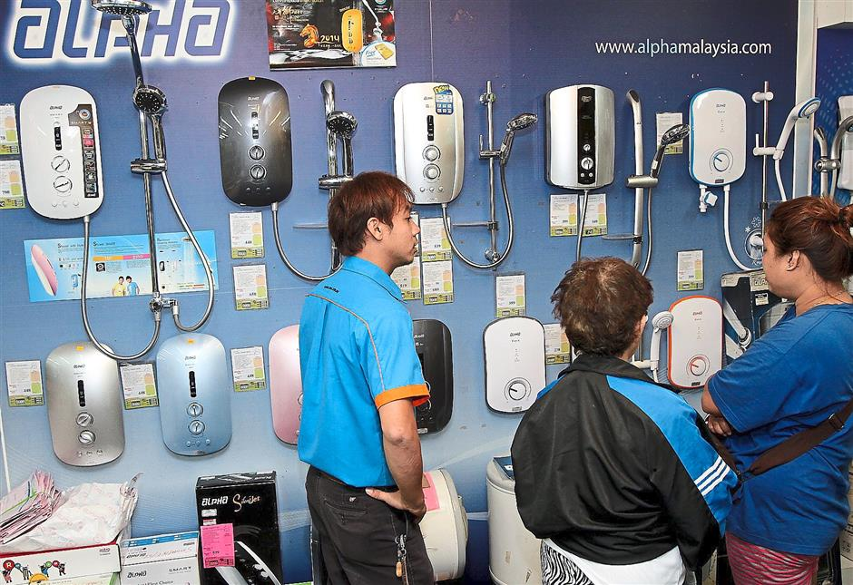 Lots of coaxing needed: Customers viewing household appliances at a SEC store in Bukit Jambul, Penang.