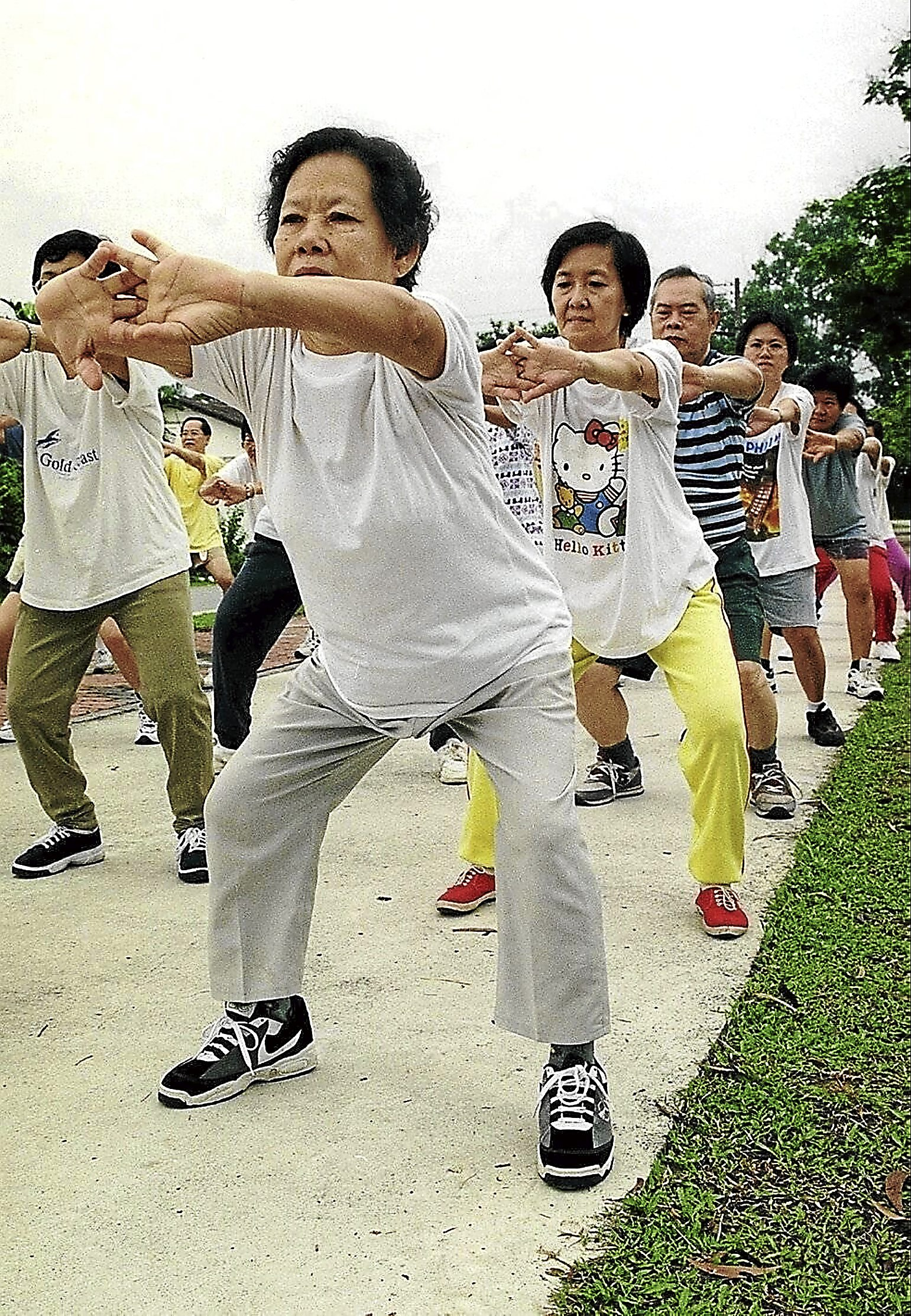 NG AH NUI (IN FRONT) 68, ONE OF THE MANY WHO TOOK PART IN A MORNING EXERCISE GROUP WHO START EARLY IN THE MORNING IN THE SS3 COMMUNITY HALL PARK.