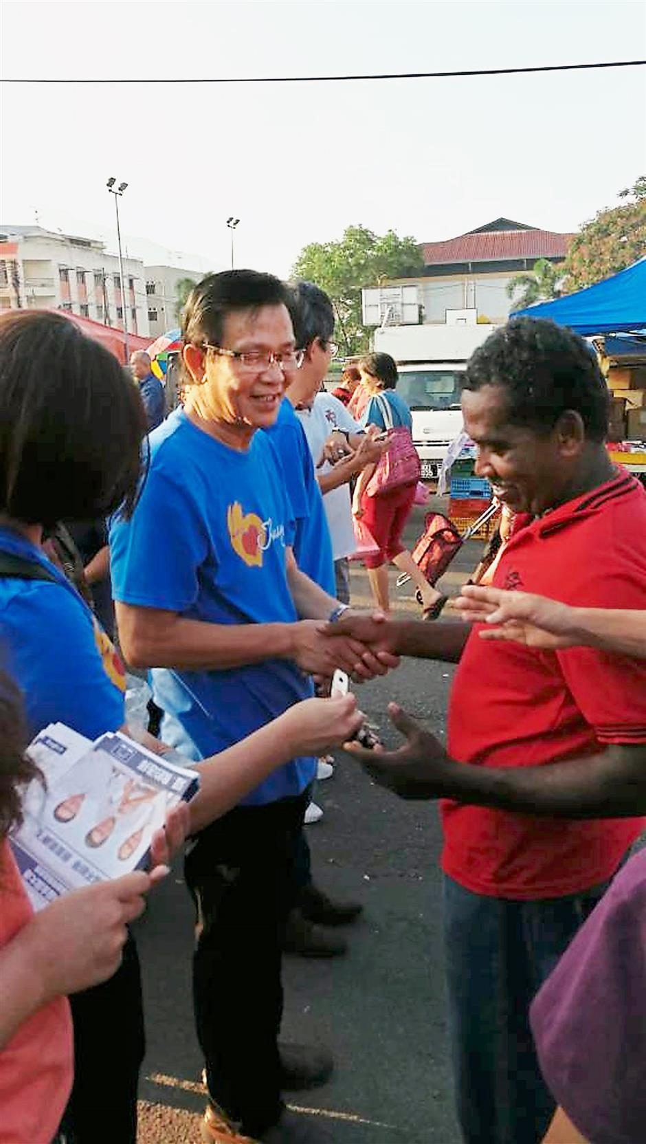 Chin (left) meeting the people in Kluang.