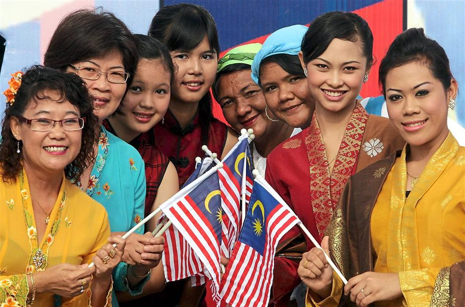 The many colours of historic Malaccau2019s unique communities reflecting the 1Malaysia spirit of unity in diversity during the 52nd Merdeka celebrations held at the Melaka International Trade Centreu2019s main hall in Ayer Keroh yesterday.