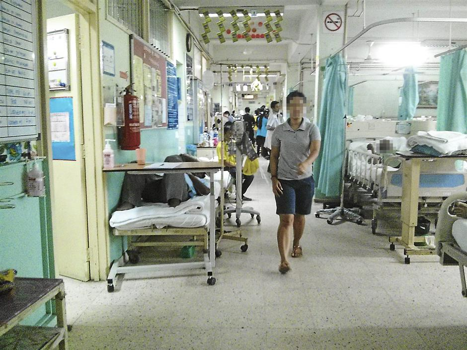 Out of space: Patients were warded along the corridor in Kajang Hospital due to lack of ward space. The hospital wards were running on over the maximum capacity.