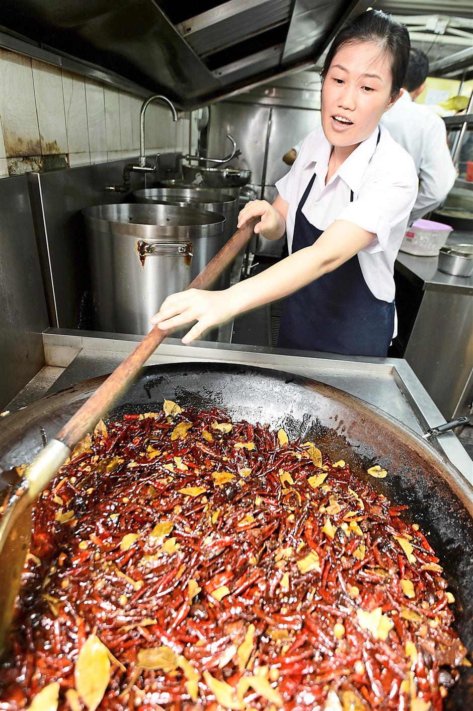 4 The chillies and ingredients for the spicy soup base is stirred for 11 hours.