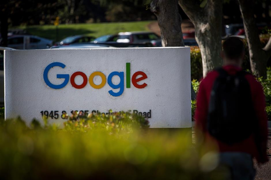 A pedestrian walks past signage at Google Inc. headquarters in Mountain View, California, U.S., on Wednesday, April 25, 2018. Alphabet Inc. is pushing efforts to roll back the most comprehensive biometric privacy law in the U.S., even as the company and its peers face heightened scrutiny after the unauthorized sharing of data at Facebook Inc. Photographer: David Paul Morris/Bloomberg