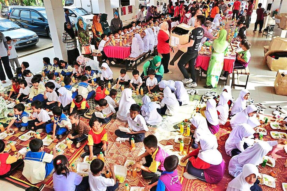For the children: Freemarket Canteen was held at a school in Pasir Mas, Kelantan during their there trip last month.