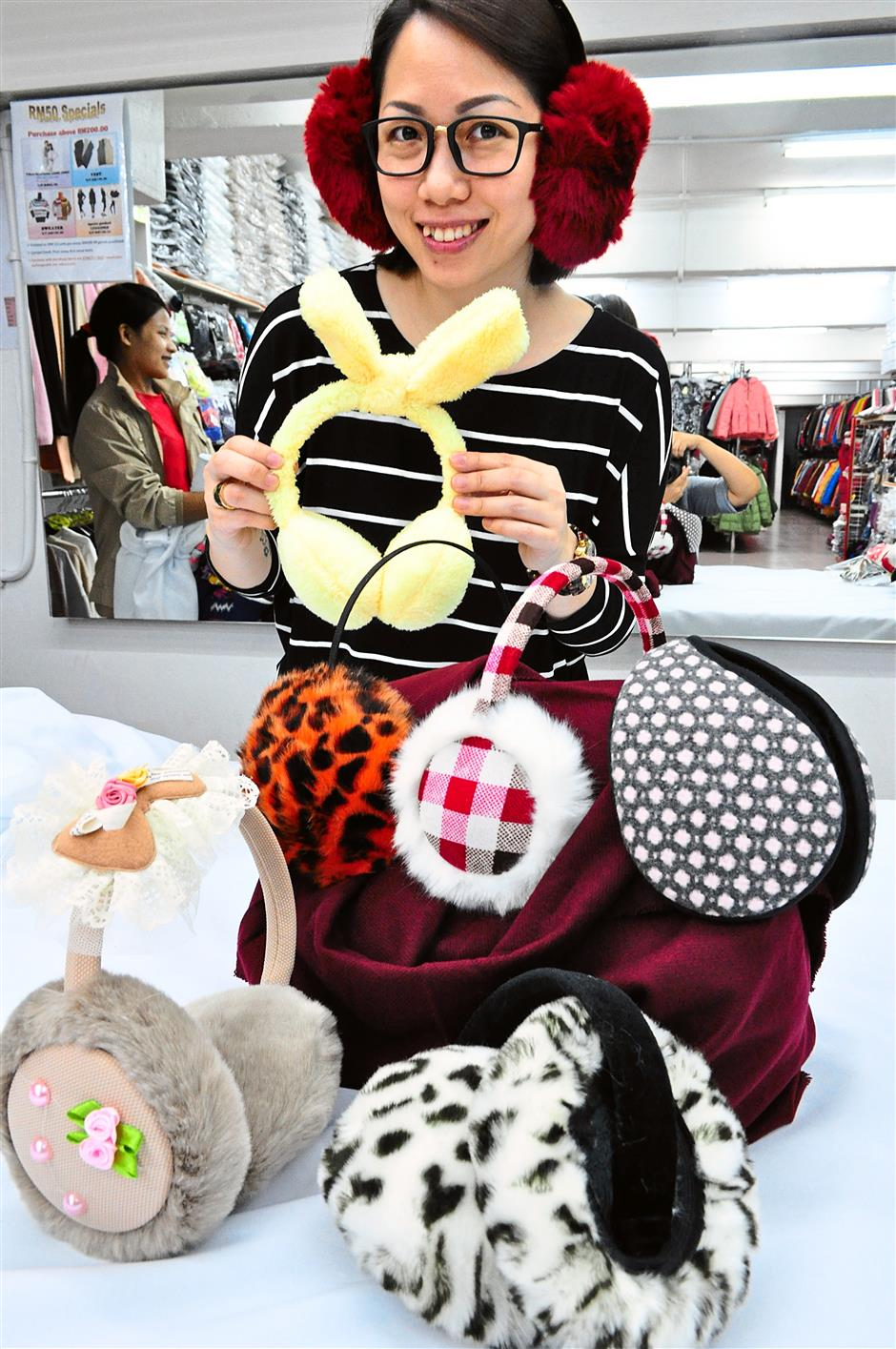 Yuki showing off Kok Kong's line of earmuffs, in fashion for the past five years.