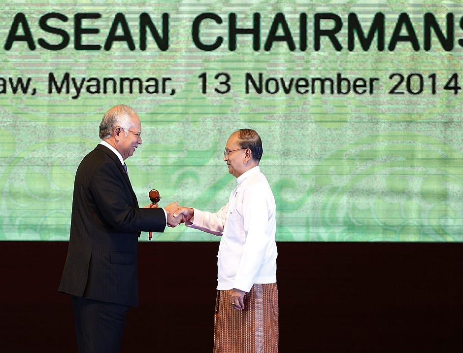 Over to you Myanmar President Thein Sein handing the gavel, the symbol of chair nation of Asean, to Najib as they shake hands, indicating the handover to 2015 host Malaysia, at the Myanmar International Convention Centre in Naypyitaw. — EPA
