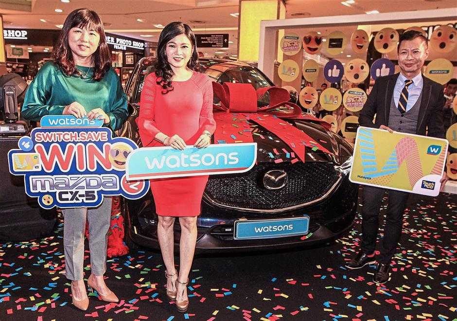 Loh (centre) with Hoh (right) and Mazda Malaysia marketing and CRM head Lee Ai Hoon (left) at the Watsons card anniversary celebrations.