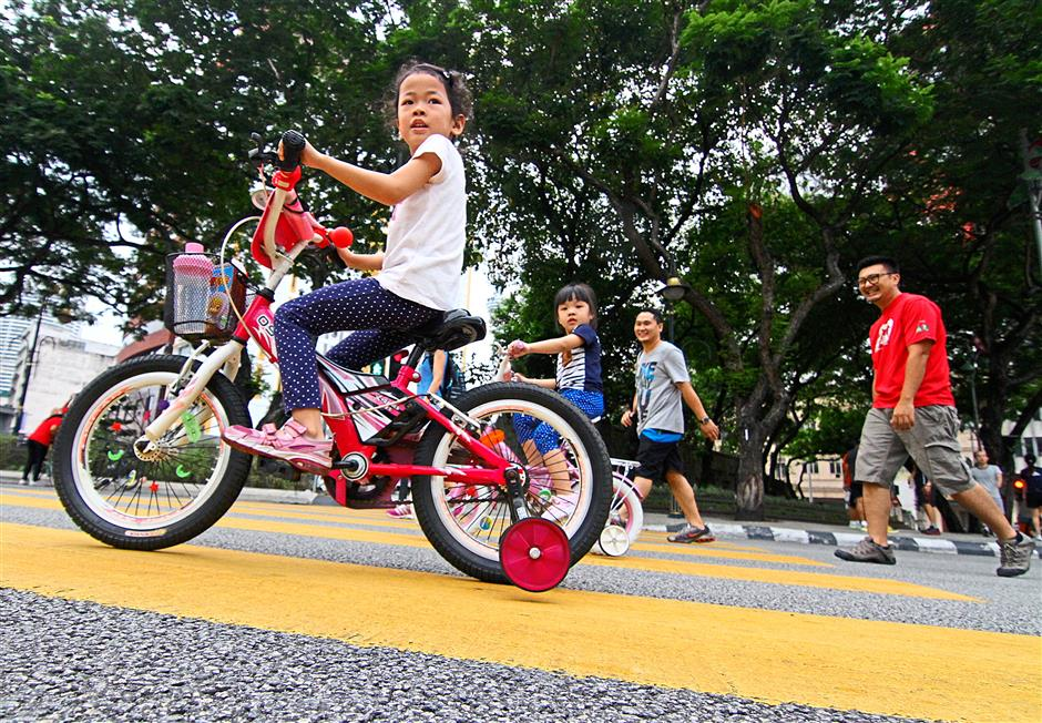 The only time when young children can cycle through downtown KL.