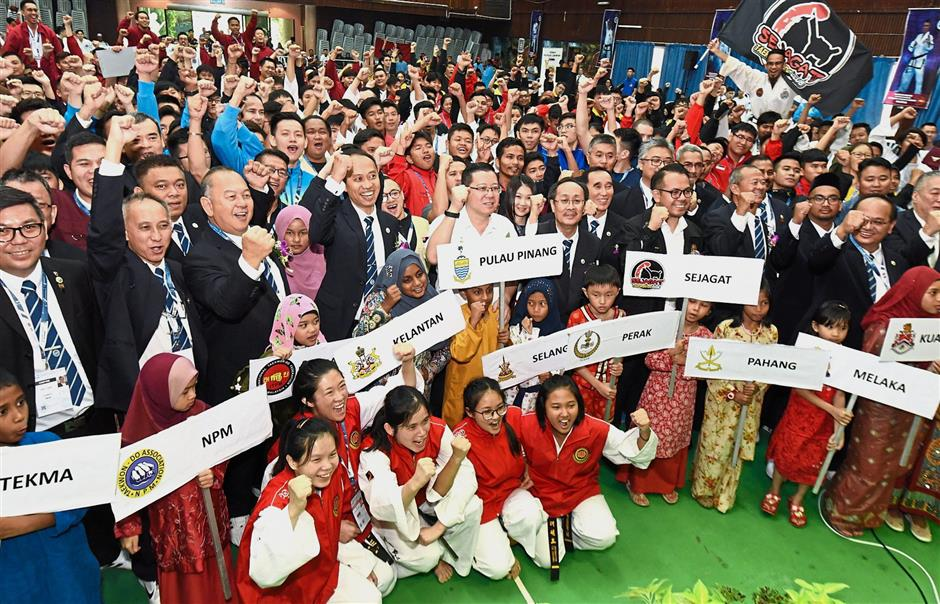 Lim (centre, white shirt) posing with participants and committee members of the taekwondo associations during the launch of the championship at Dewan Sree Mariamman in Butterworth, Penang. — Photos by MUSTAFA AHMAD/The Star