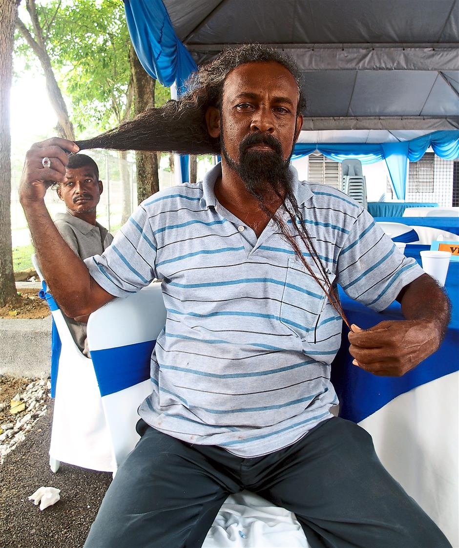 Living legend: Malaysia's strongman Sando G. Dheva, who has pulled a 110tonne ship with his hair, lives in Kampung Baru Sungai Buloh too.