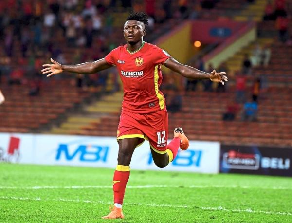 Hot form: Ifedayo Olusegun reeling away after scoring the opening goal for Selangor against Kuala Lumpur on Saturday. u2014 Bernama