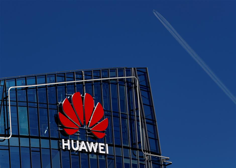 Huawei sign is seen on a building in Vilnius, Lithuania March 30, 2019. REUTERS/Ints Kalnins