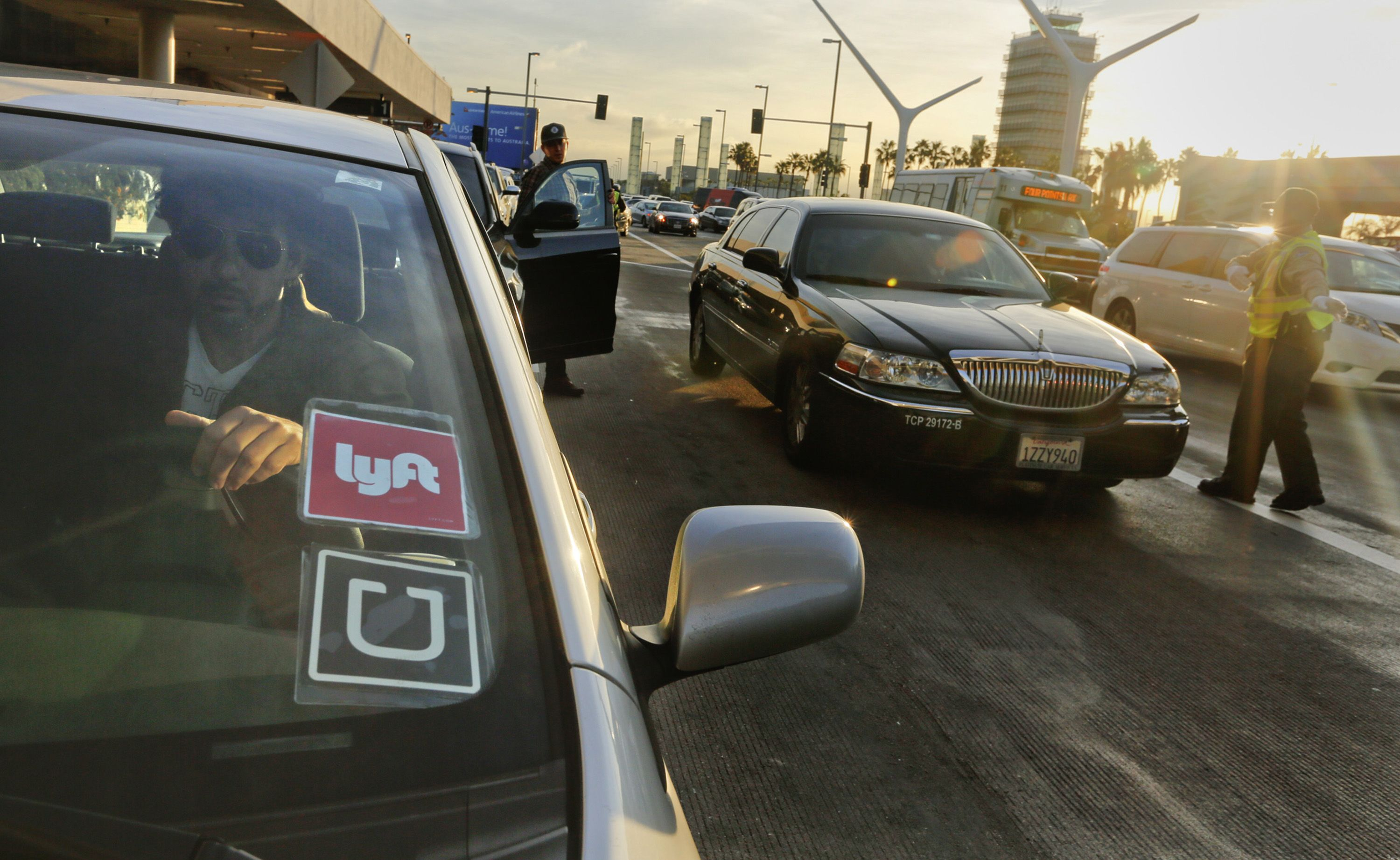 Some states and localities are starting to tax ride-hailing services such as Uber and Lyft, a sign governments seek to overhaul their tax structures in response to a rapidly changing economy. (Mark Boster/Los Angeles Times/TNS)