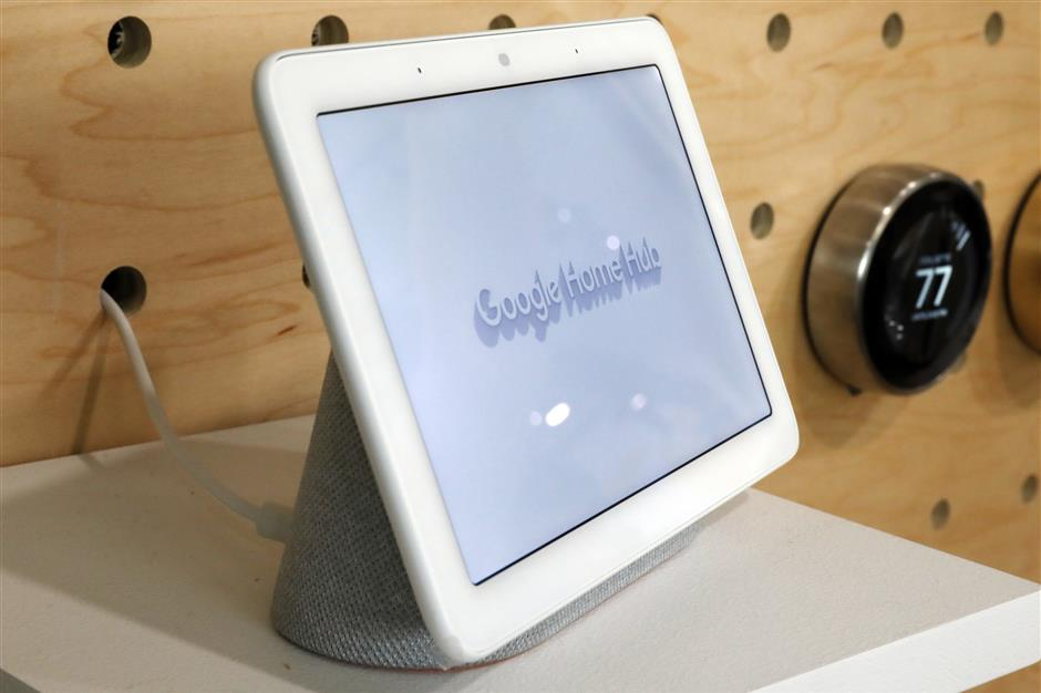 FILE - In this Oct. 9, 2018, file photo a Google Home Hub is displayed in New York. Google contractors are listening to some recordings of people talking to Assistant, either on their phone or through smart speakers such as the Google Home. The company says some of its Dutch language recordings were leaked and that it is investigating. (AP Photo/Richard Drew, File)