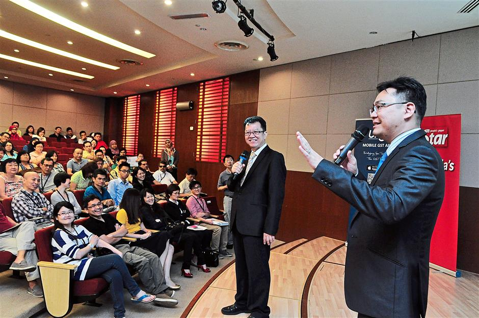 Addressing queries: Loh (left) and Chin of UHY during a question-and-answer session at the workshop in Menara Star, Petaling Jaya.