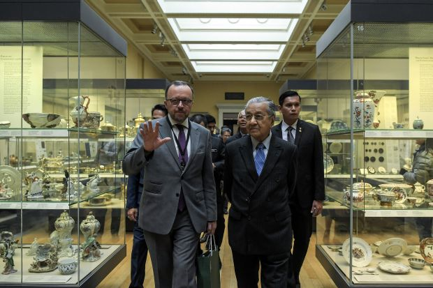 Private tour: Dr Mahathir listening to Williams during his visit to the Albukhary Foundation Gallery of the Islamic World at the British Museum in Bloomsbury, London.u2028 u2014 Bernama