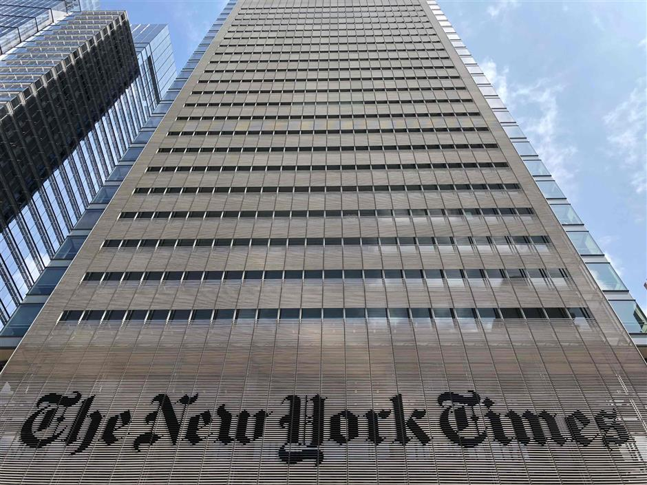 (FILES) In this file photo taken on August 21, 2018, the New York Times building on 8th Avenue is seen in New York City. - The New York Times said on November 1, 2018, that digital subscriptions topped three million in the past quarter, keeping the prestigious daily profitable in a difficult environment for the news media. (Photo by Daniel SLIM / AFP)