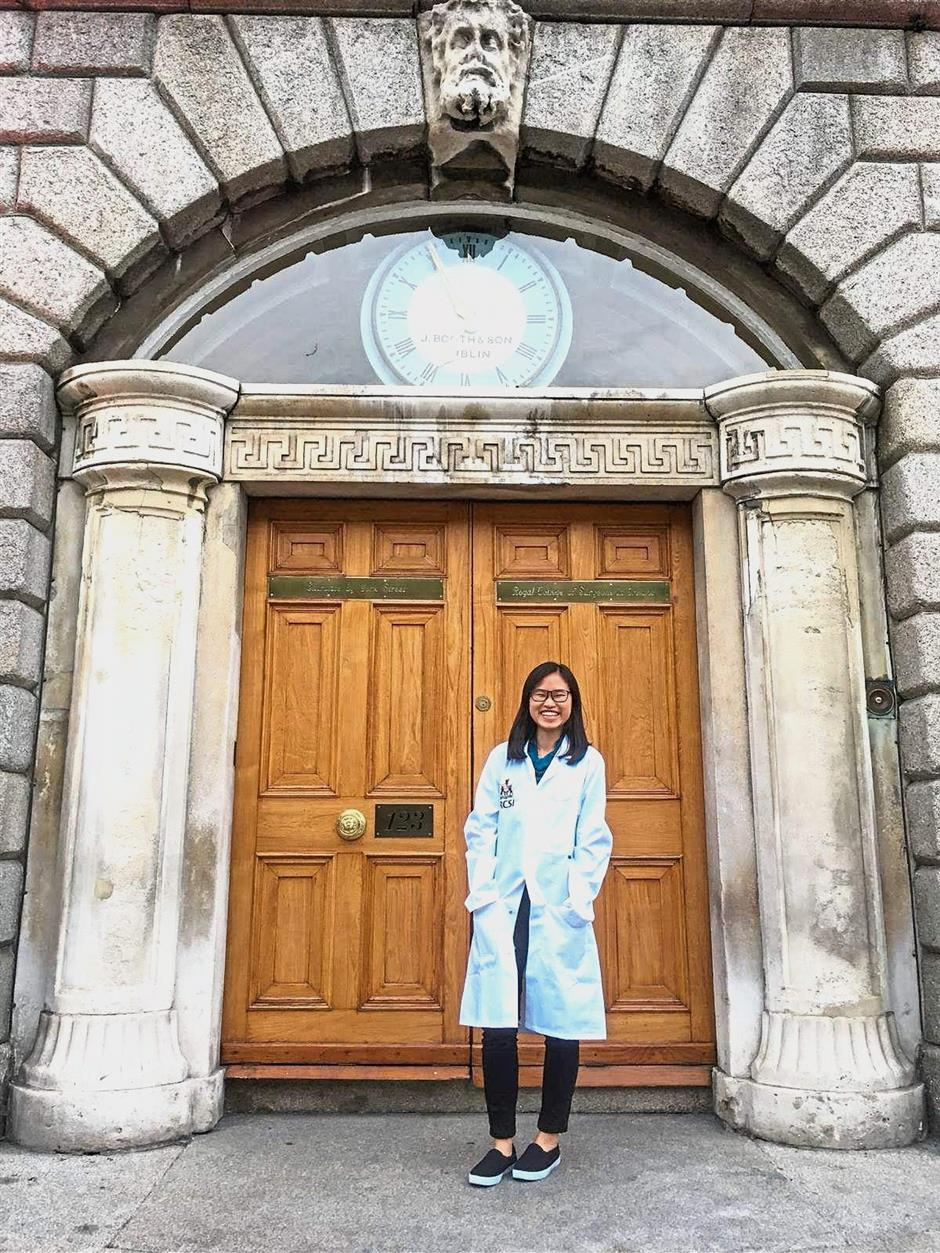 Chan marks the White Coat ceremony with a photo at the main entrance of the old RCSI building.