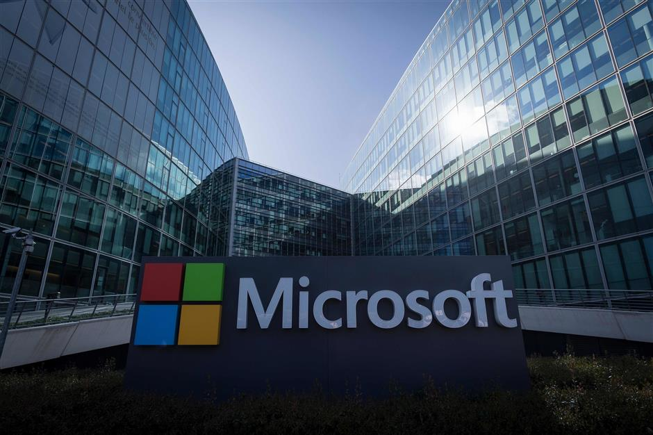 (FILES) In this file photo taken on April 17, 2017 the French headquarters of Microsoft are seen in Paris. - Microsoft is back at the top of the technology world following an extraordinary comeback to close the gap with Apple, some three years into a transformation of the onetime leader by chief executive Satya Nadella. Microsoft regained its title as the world\'s most valuable company when it closed on November 30, 2018, at a higher market value than Apple for the first time since 2010, after a brief move ahead of the iPhone maker earlier in the week. (Photo by Lionel BONAVENTURE / AFP)
