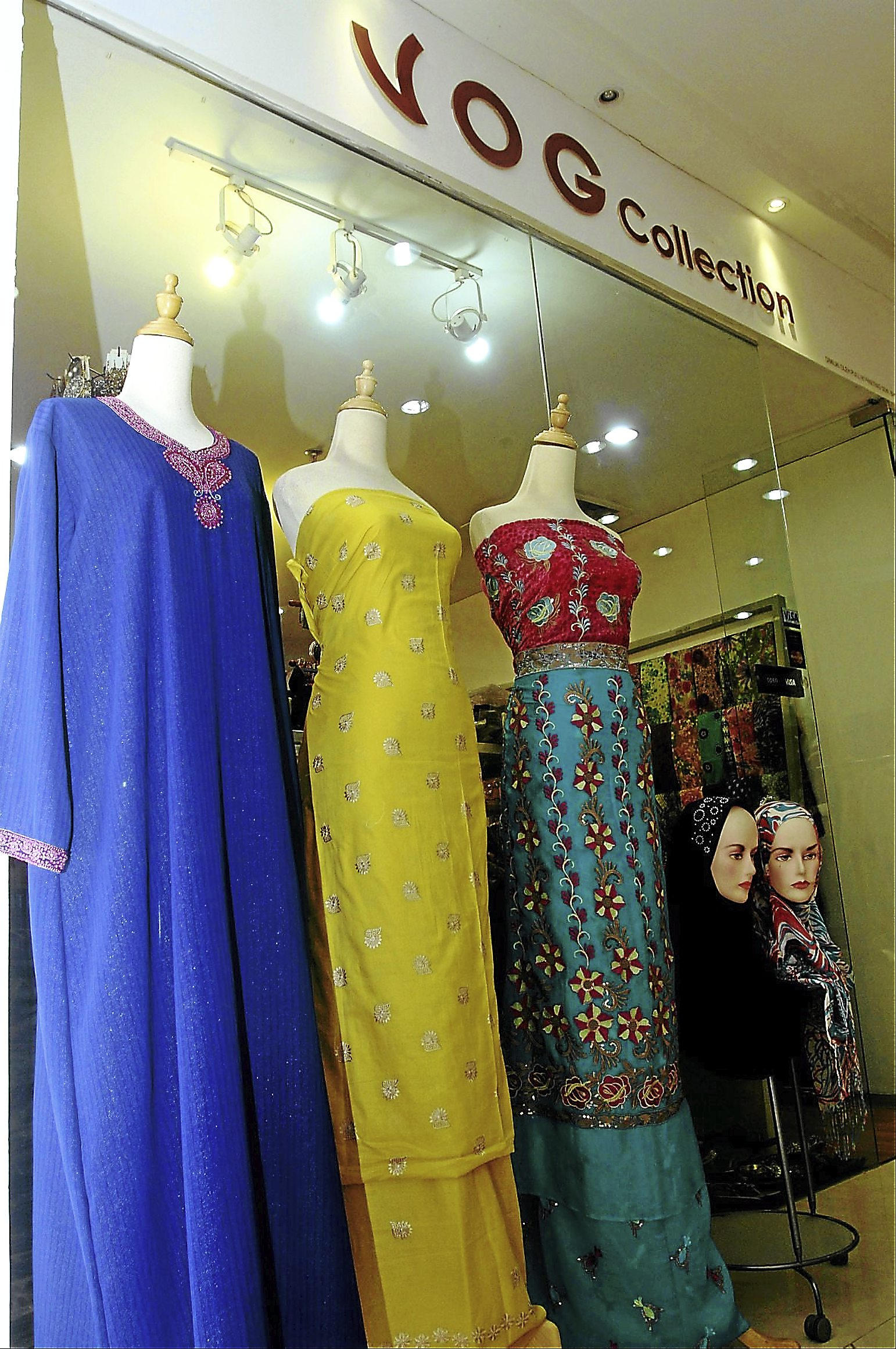 Karina - Metrobiz  interview with Fasia, owner of a female Muslim apparel/cloth retail business (for Hari Raya feature).