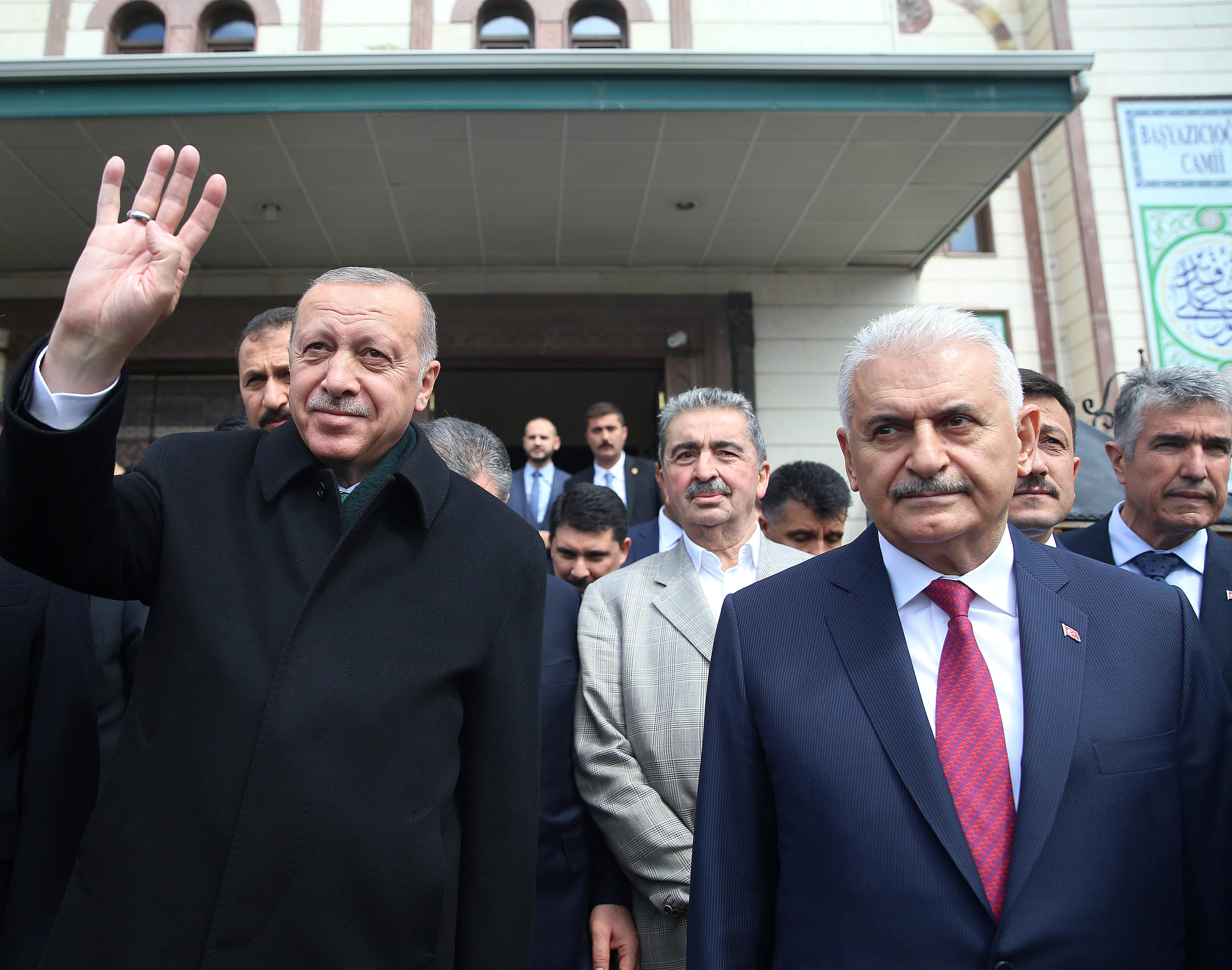 FILE PHOTO: Turkish President Tayyip Erdogan is flanked by Binali Yildirim, mayoral candidate of the ruling AK Party in Istanbul, as they leave a mosque together after Friday prayers in Ankara, Turkey, April 12, 2019. Murat Cetinmuhurdar/Presidential Press Office/Handout via REUTERS